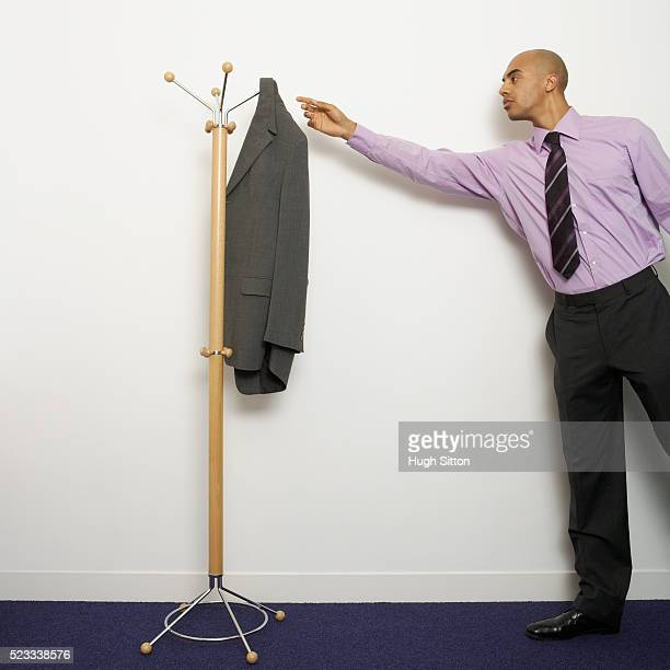 Businessman Reaching for Jacket