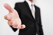 Businessman reaching hand at front, selective focus, shallow depth of field