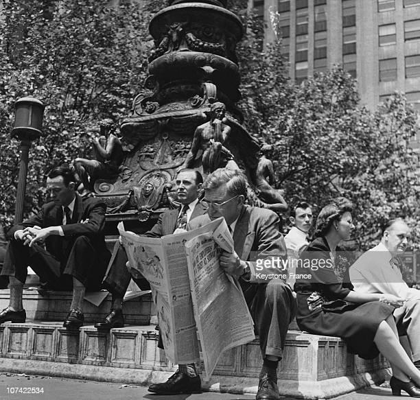 Businessman Reading A Newspaper In Manhattan In New YorkUsa
