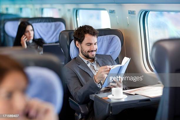 Businessman reading  book  on Train