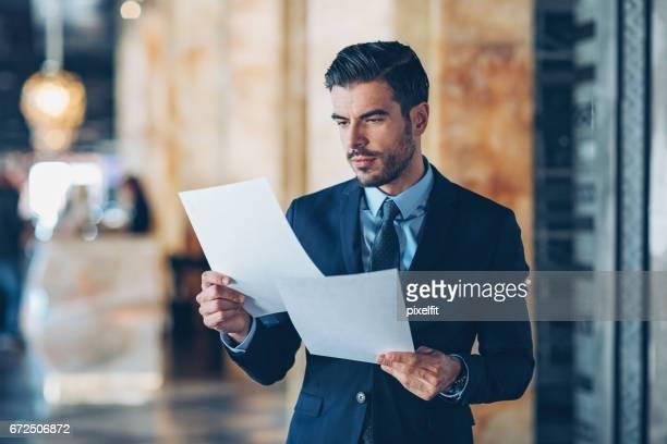 Businessman reading documents