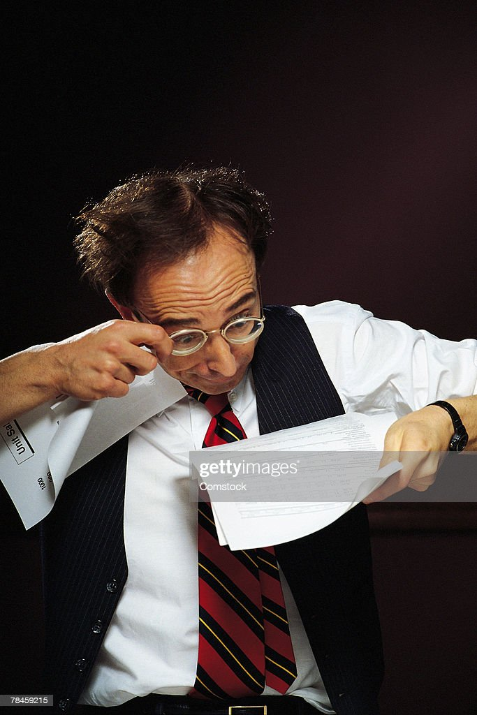 Businessman reading fine print