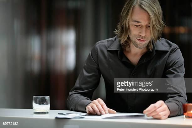 Businessman reading in bar