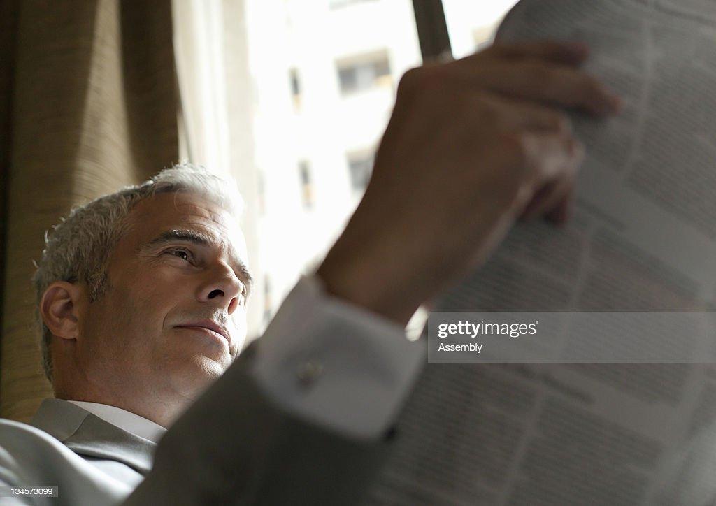 Businessman reading newspaper. : Stock Photo