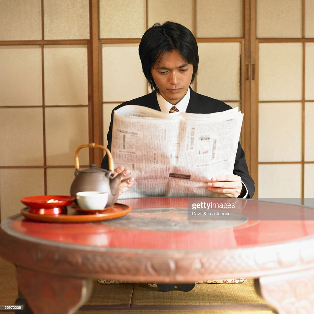 Businessman reading newspaper : Stock Photo