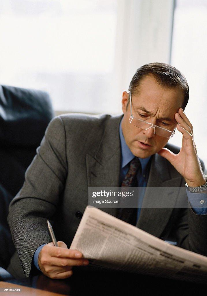 Businessman reading : Stock Photo