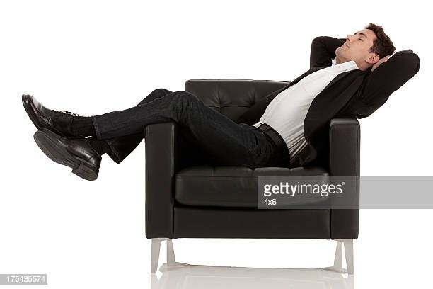 Businessman reclining in an armchair