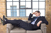 Businessman reclining on a couch