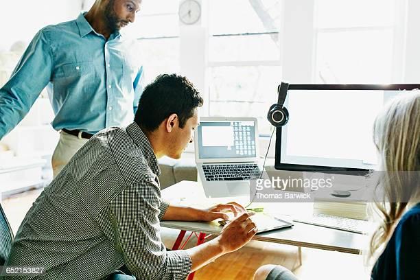 Businessman referencing data on digital tablet