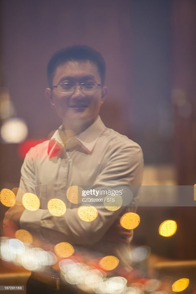 businessman reflection on evening window : Stock Photo