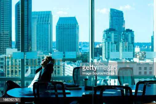 Businessman relaxing at desk in office : Stock Photo
