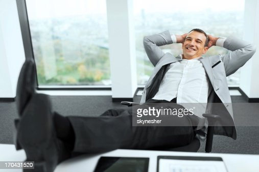 Businessman relaxing in his office.