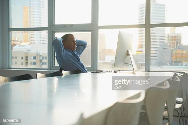 Businessman relaxing in modern office