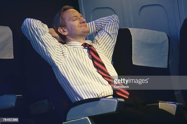 Businessman relaxing on flight