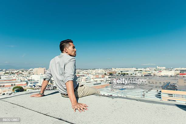 Businessman relaxing on roof terrace, Los Angeles, California, USA