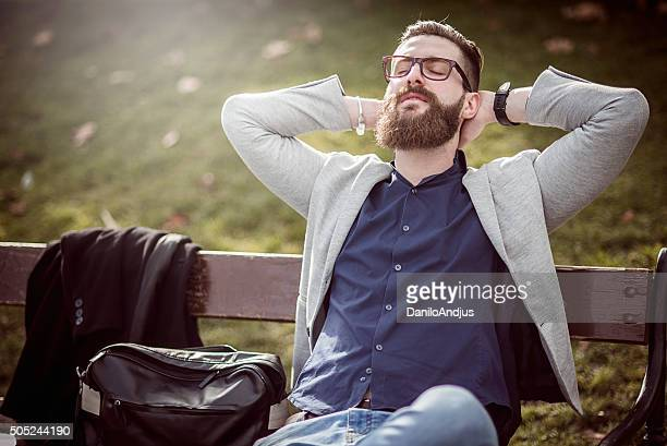 businessman relaxing on the bench after work
