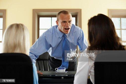 Businessman Reprimanding Subordinates