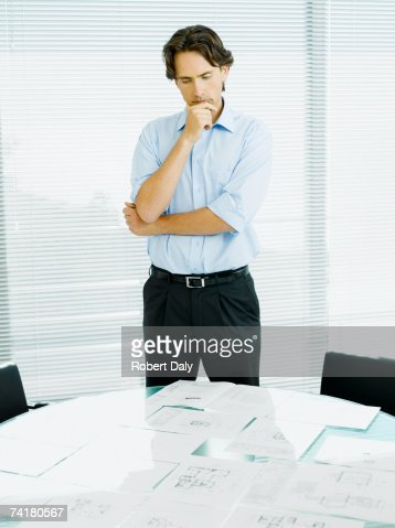 Businessman reviewing documents : Stock Photo
