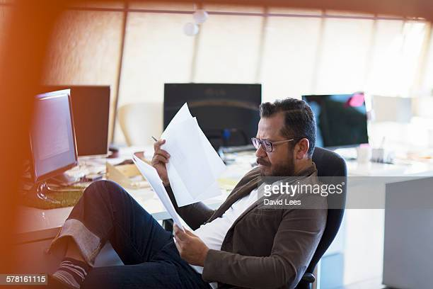 Businessman reviewing paperwork in office