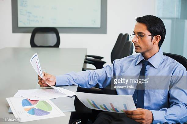 Businessman reviewing pie chart