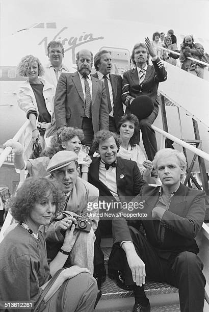 Businessman Richard Branson poses with various celebrities on steps leading up to a Virgin Atlantic Boeing 747200 at Gatwick airport in England...