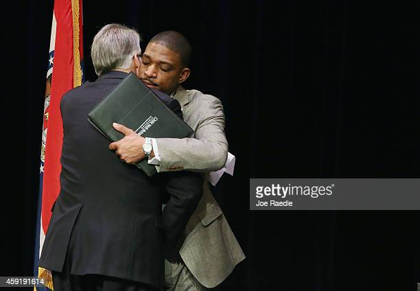 Businessman Richard McClure and minister Starsky Wilson embrace after Missouri Governor Jay Nixon annouced them as the cochairs of a 16member...