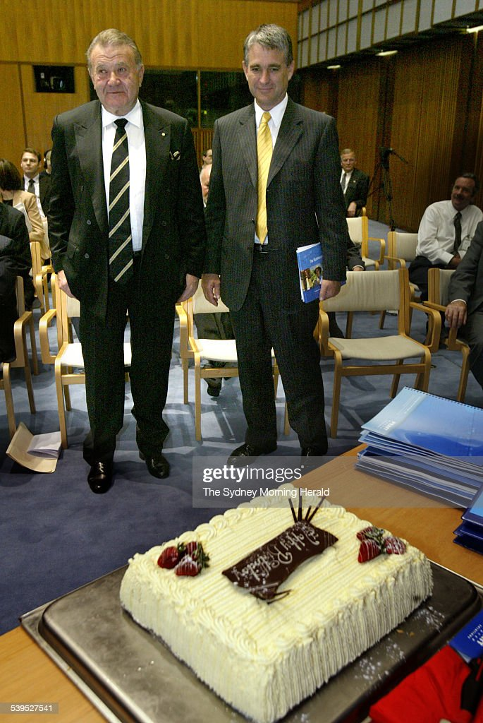 Businessman Richard Pratt with a surprise birthday cake and Deputy Prime Minister John Anderson at the handing over of The Business of Saving Water...