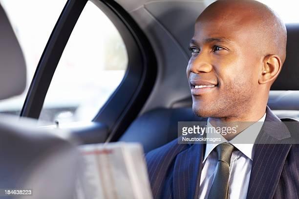 Businessman Riding in a Car