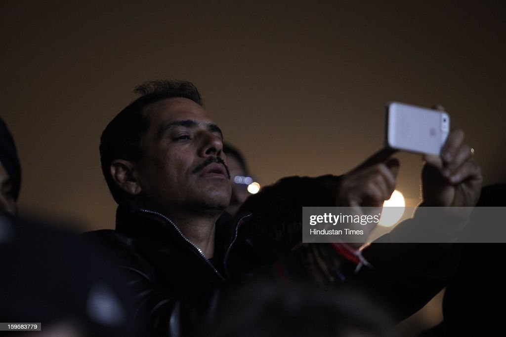 Businessman Robert Vadera clicking pics on his mobile during American rapper Snoop Dogg concert at Gurgaon's Leisure Valley Park on January 13, 2013 in Gurgaon, India.