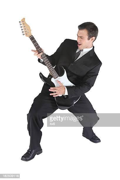 Geschäftsmann Schaukeln Sie mit guitar
