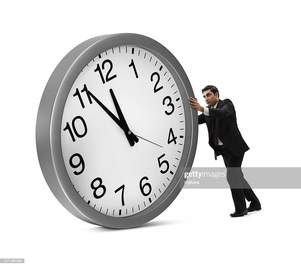 Businessman Rolling Big Clock
