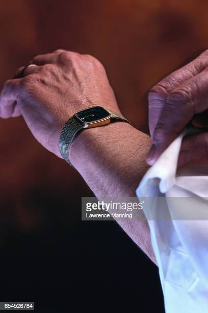 Businessman Rolling up Sleeve