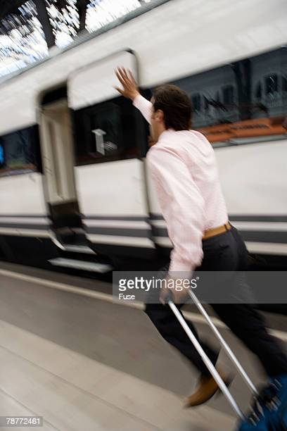 Businessman Running after Departing Train