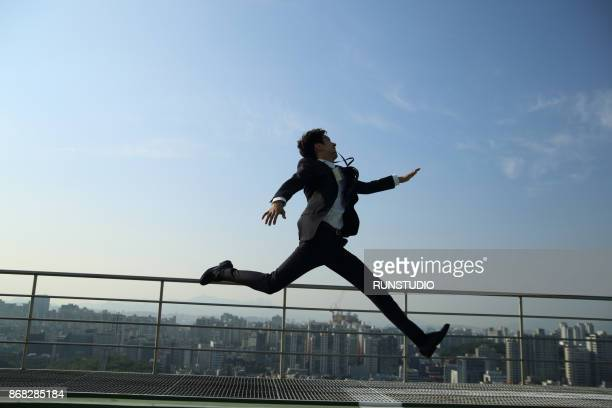 Businessman running and jumping