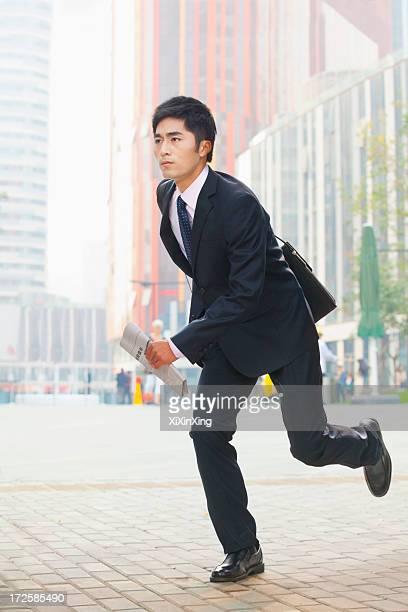 Businessman running, Beijing, China