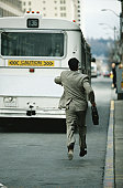 Businessman Running for a Bus