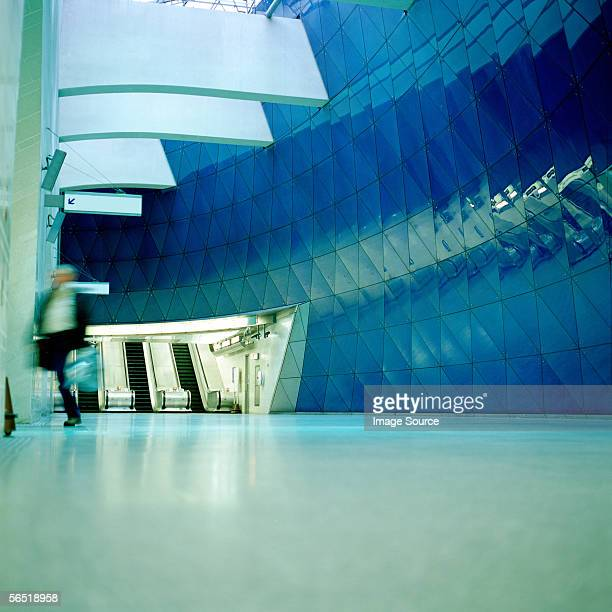 Businessman running in entrance hall