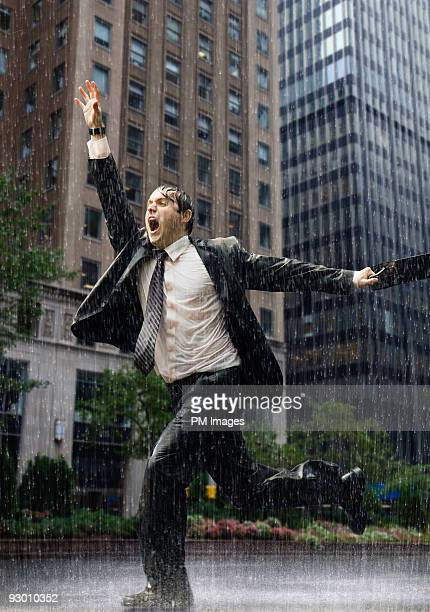 Businessman running in rain