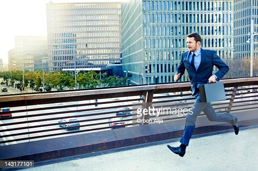 Businessman running in the city