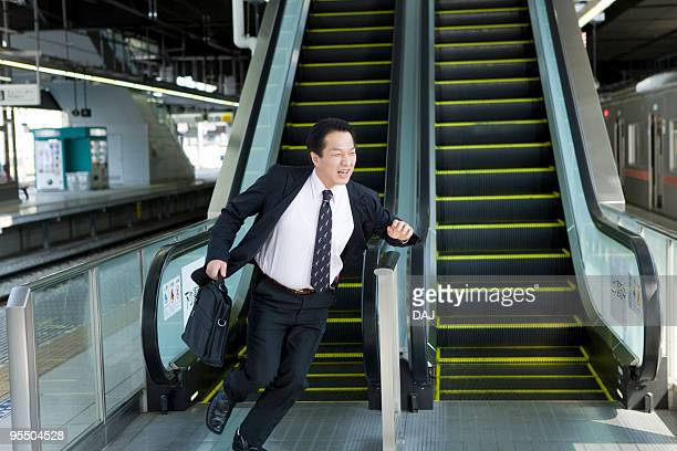 Businessman running in the platform