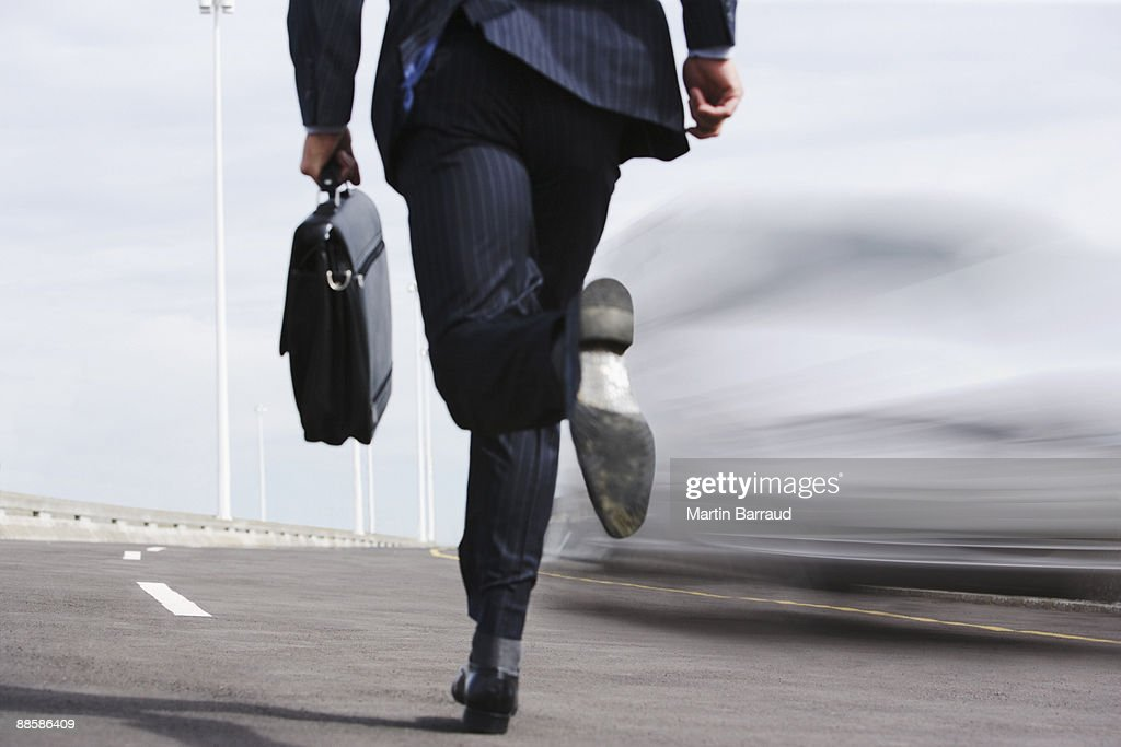 Businessman running on road : Stock Photo