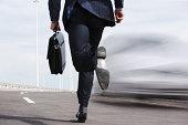 Businessman running on road