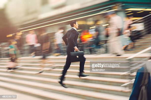 Businessman running on the street