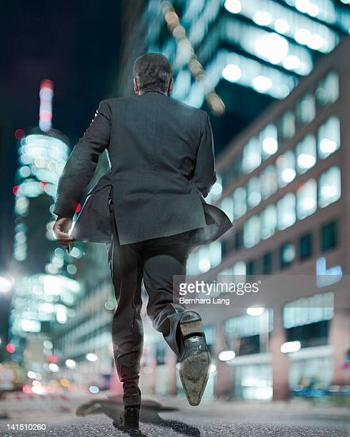 Businessman running, rear view