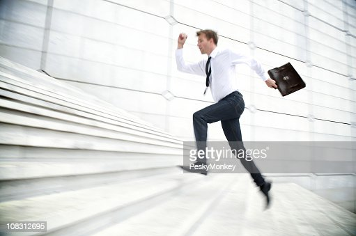 Businessman Running Up White Staircase