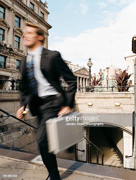 Businessman rushing up stairs