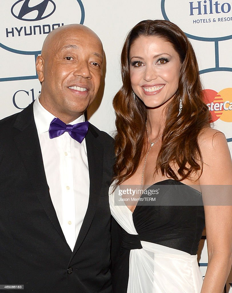 Businessman Russell Simmons and actress Shannon Elizabeth attend the 56th annual GRAMMY Awards Pre-GRAMMY Gala and Salute to Industry Icons honoring Lucian Grainge at The Beverly Hilton on January 25, 2014 in Los Angeles, California.