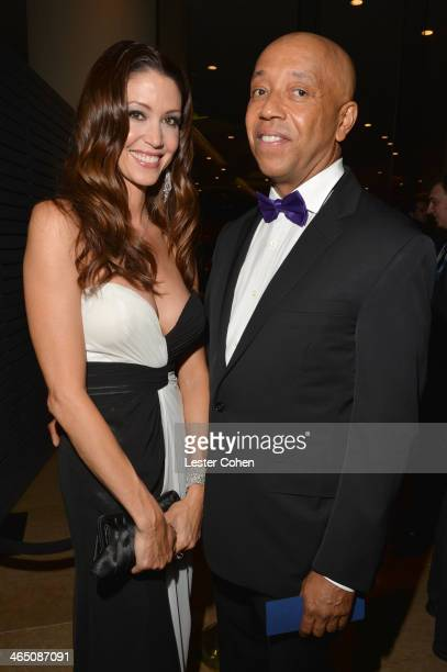 Businessman Russell Simmons and actress Shannon Elizabeth attend the 56th annual GRAMMY Awards PreGRAMMY Gala and Salute to Industry Icons honoring...