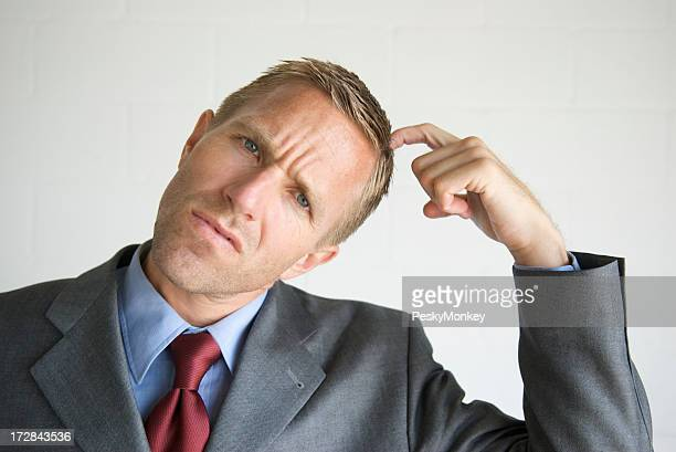 Businessman Scratching Head Looking Confused