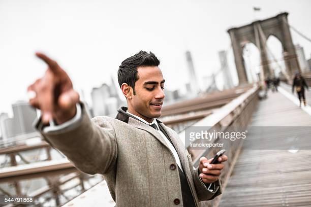 Businessman searching on the brooklyn bridge